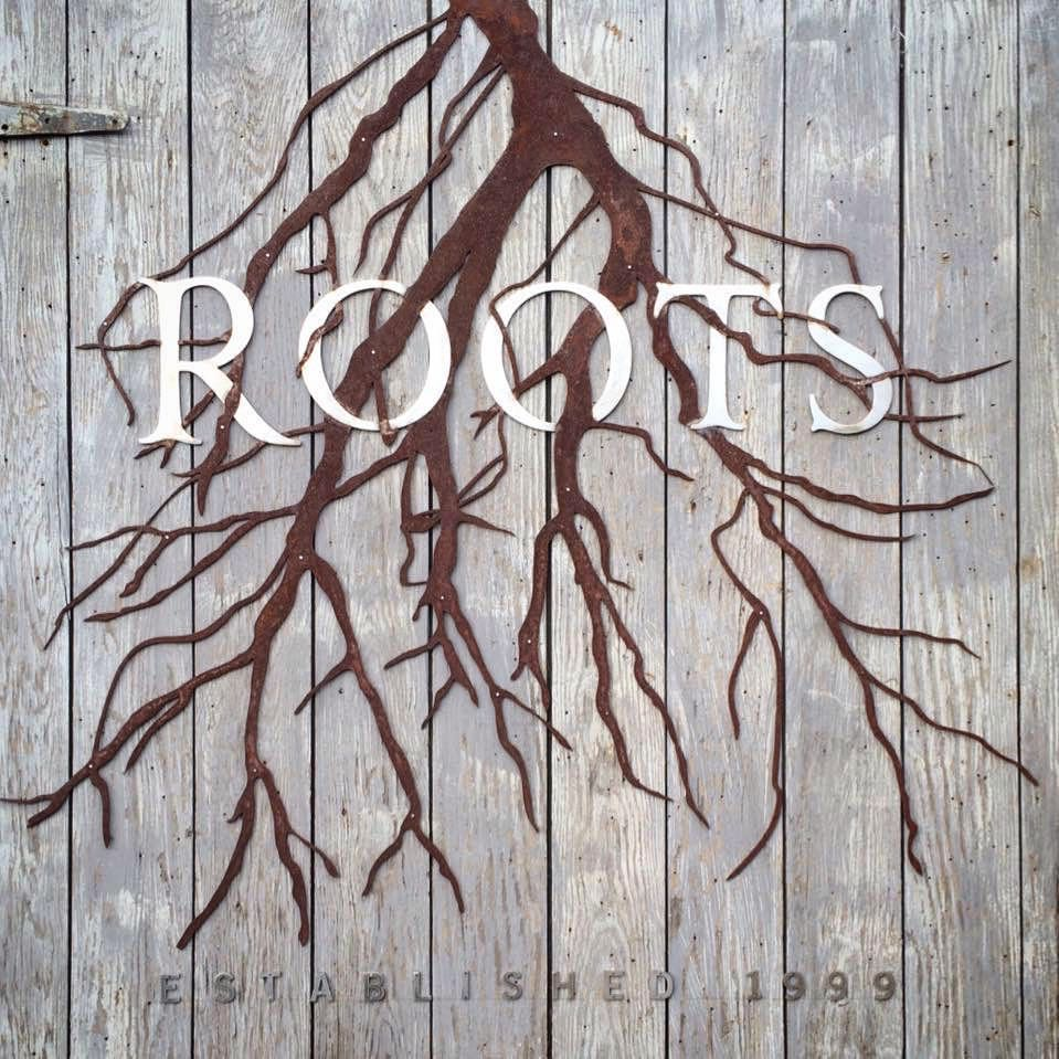 A sign that Solid Form created for Roots Wine Co.