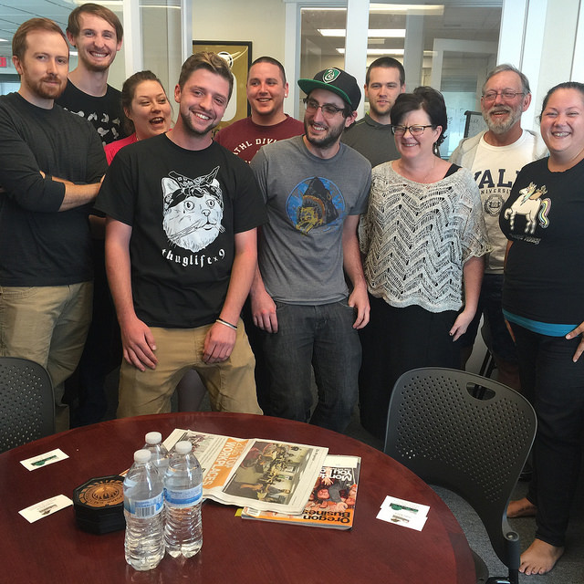 TTR Employees stand with MEDP Executive Director, Jody Christensen, on Cat Shirt Tuesday