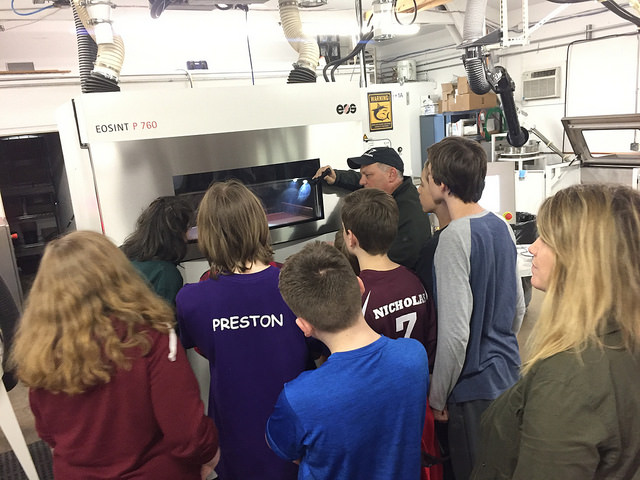McMinnville Middle School Students observe a 3D printer using a SLS (Selective Laser Sintering) Process