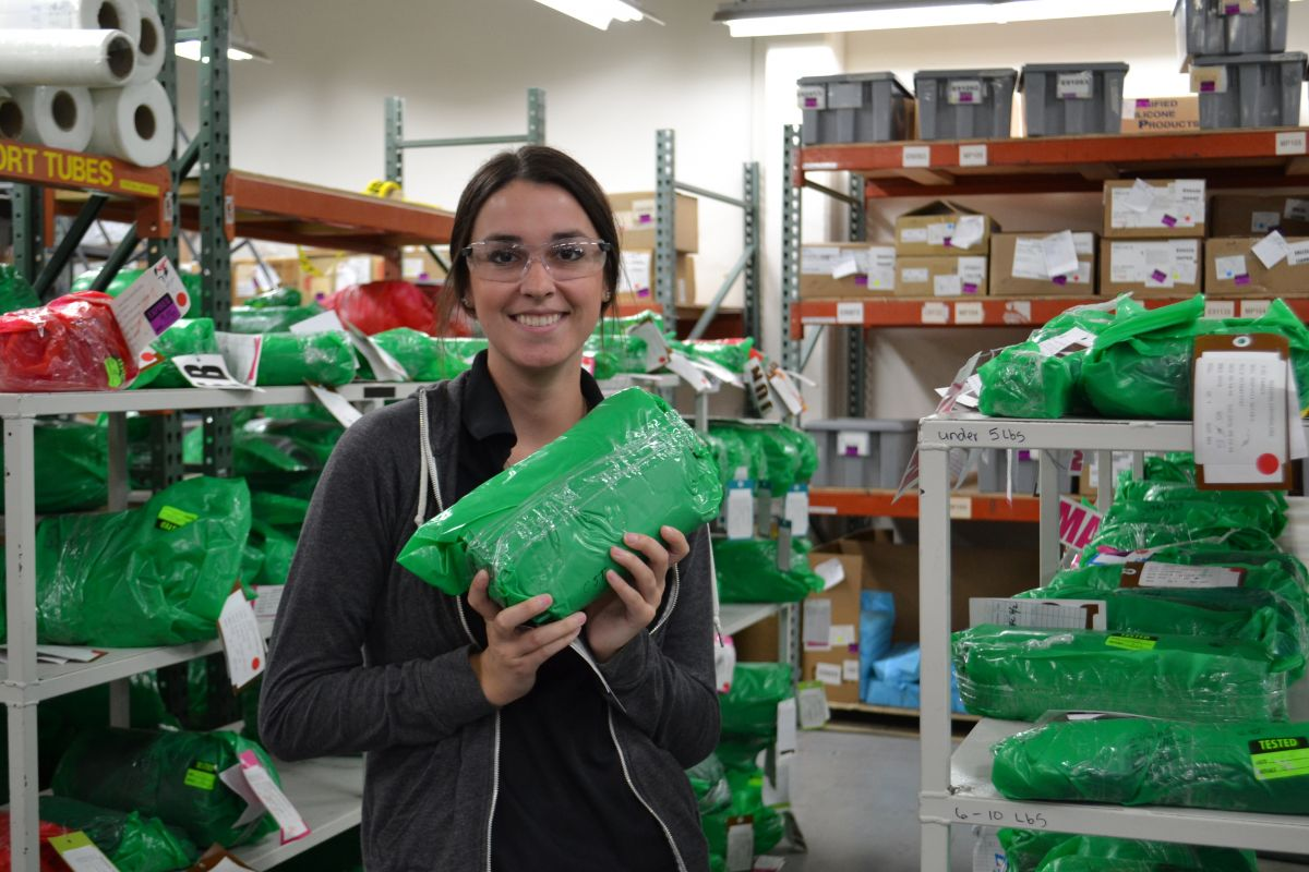 A McMinnville WORKS Intern holds a bag of silicone