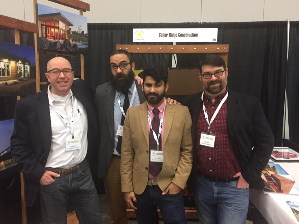 Abhi stands with the Cellar Ridge team at a building conference in Portland