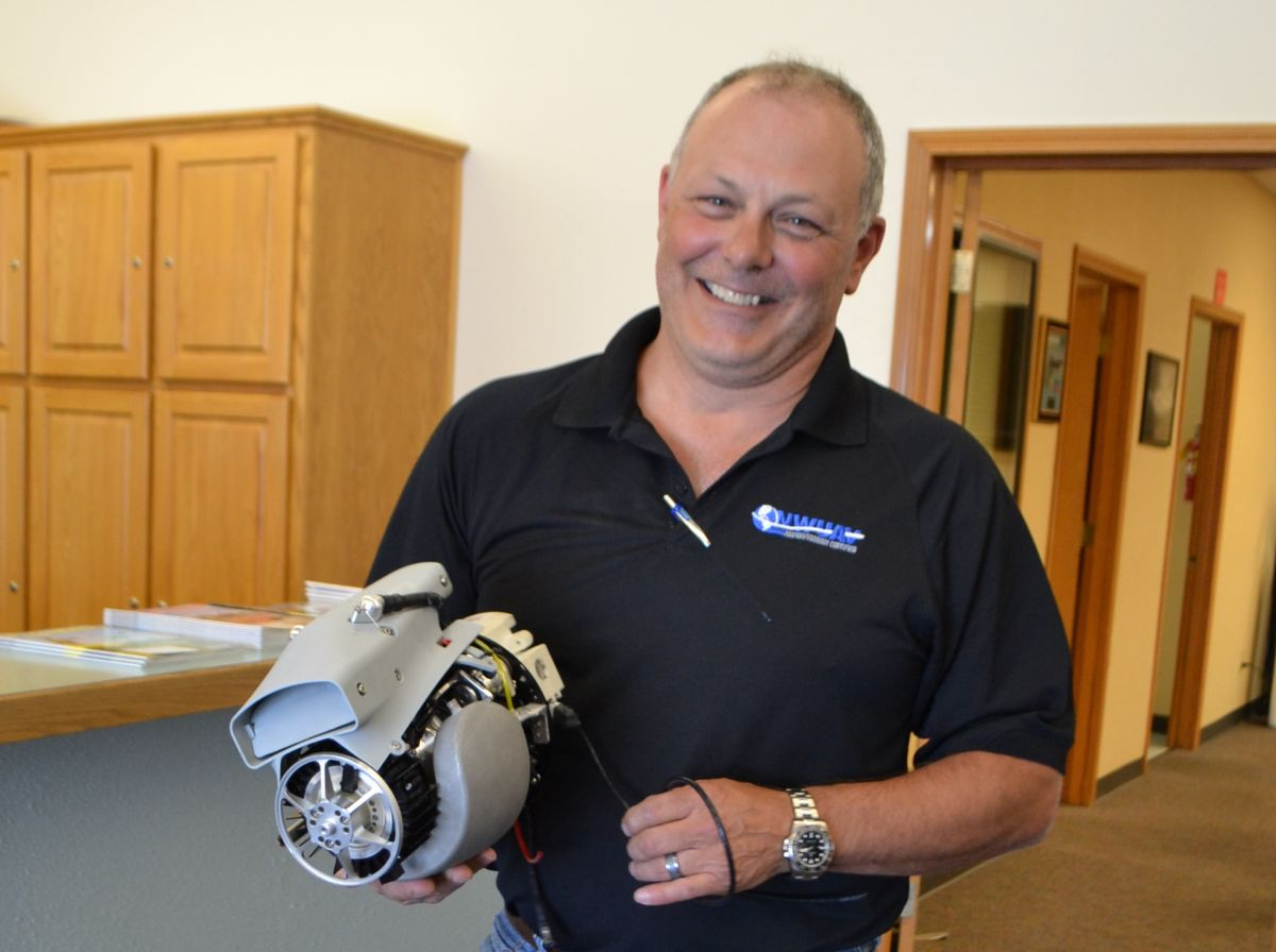 President Chris Harris holding NWUAV's NW-44 Engine