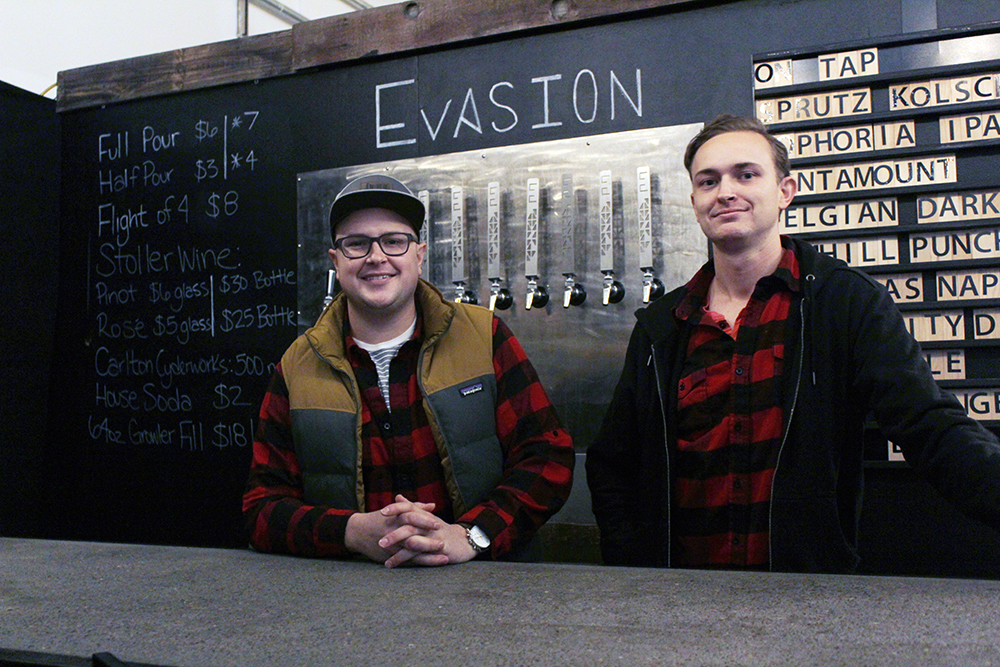 Evasion Brewing President Erik Lapp and VP of Marketing and Sales Evan Lapp behind the bar in the Evasion Tasting Room