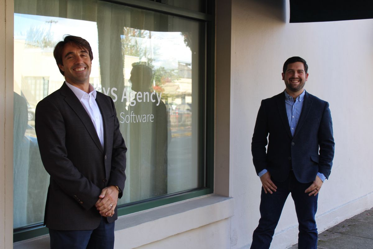 Max De Lavenne and Miles Oliveira stand outside of the LVSYS office