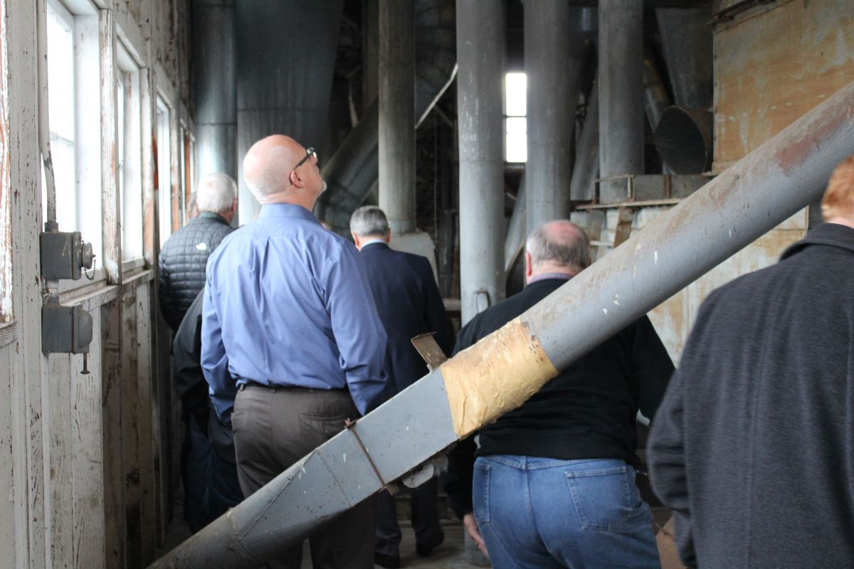 Attendees tour the top floor of the historic Buchanan Cellers building