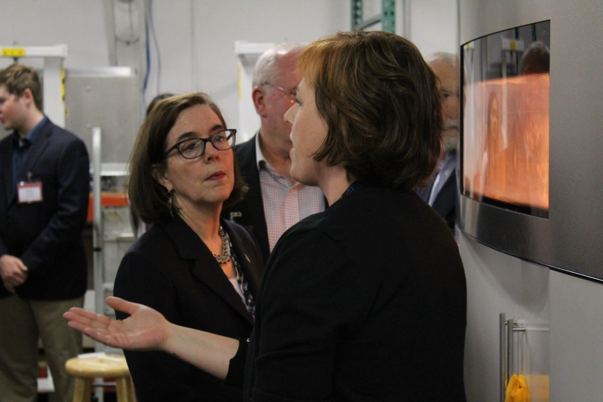 Governor Kate Brown listens to NW Rapid Manufacturing Owner, Heather Harris, explain the SLS (Selective Laser Sintering) Process