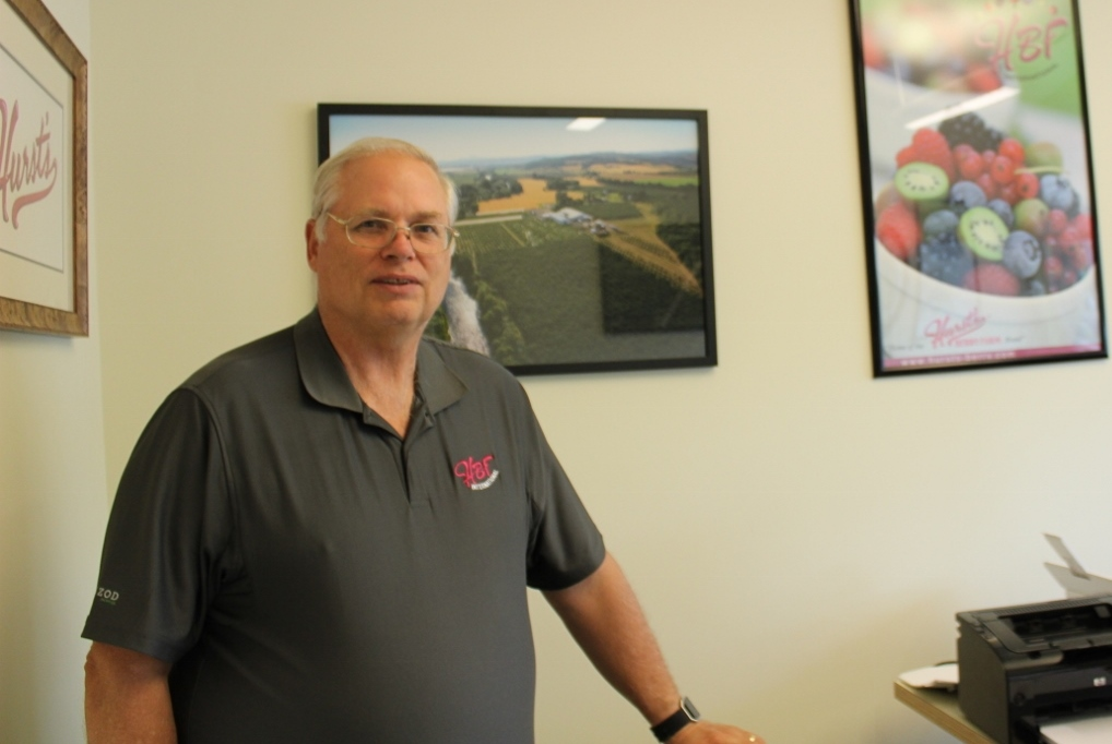 Founder and Research and Development Director, Mark Hurst, stands in his office in McMinnville, Oregon