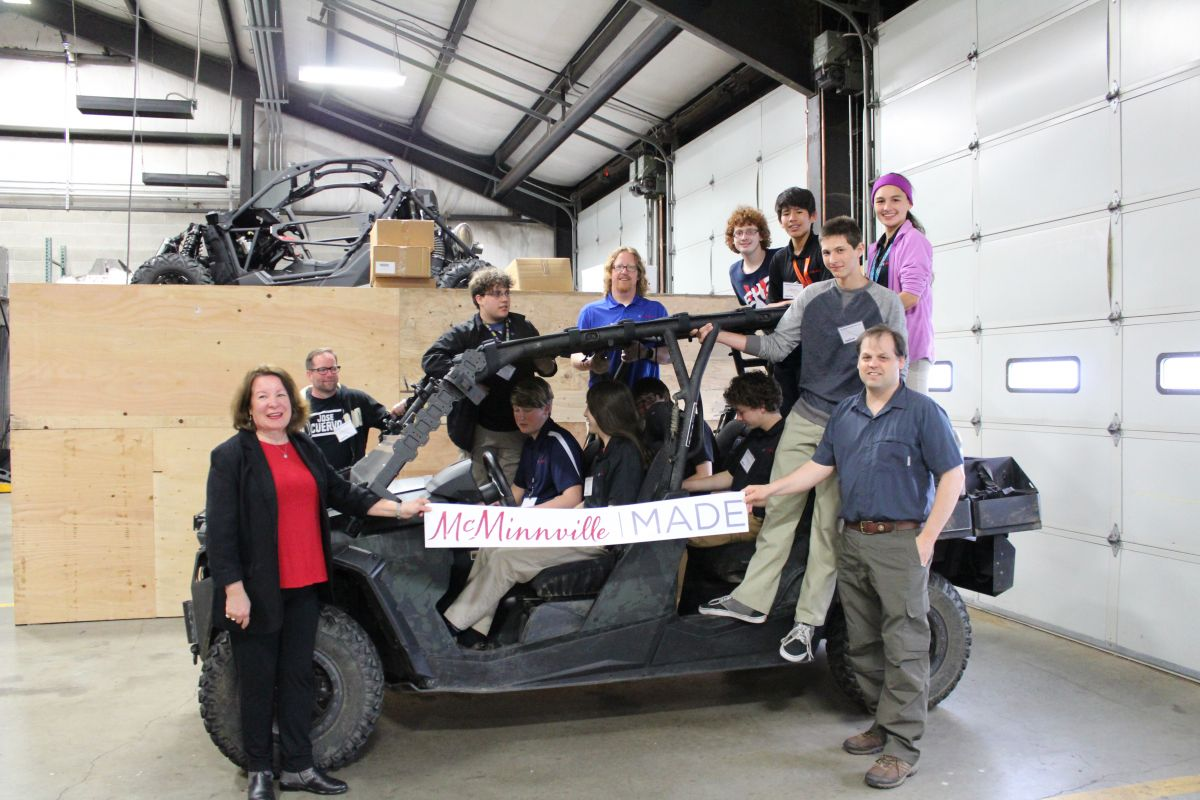 McMinnville High School Students and McMinnville City Councilor, Kellie Menke, jump into a RP Advanced Mobile Systems UTV