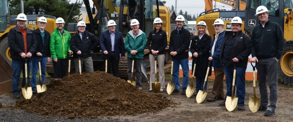 A group of community members vital to the creation and development of Alpine Avenue celebrate the groundbreaking with golden shovels.