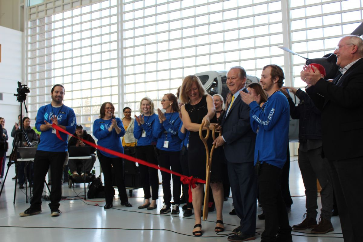 Steve Down, with his wife and son, cut a ribbon to symbolize the grand opening the Falls Event Center in McMinnville, Oregon