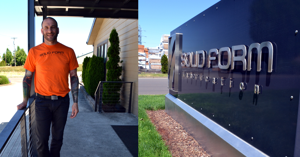 Deven Paolo stands outside the Solid Form Fabrication office