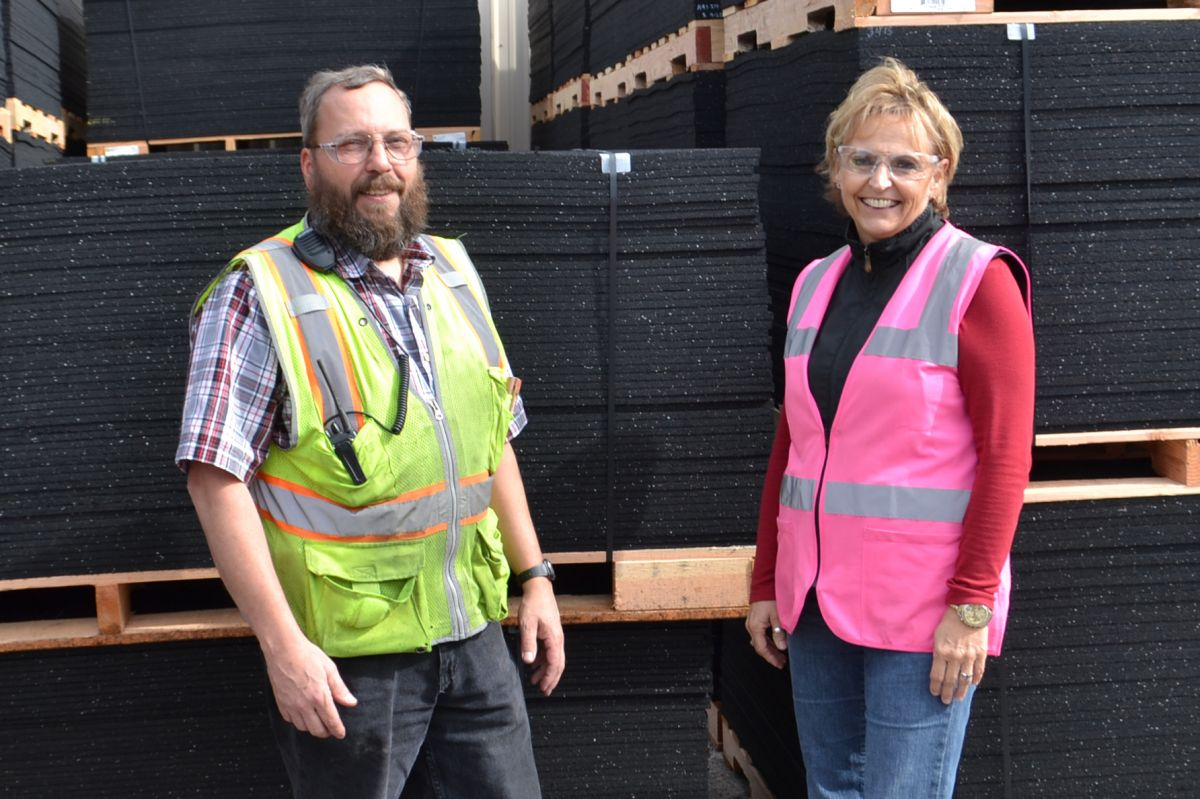 Director of Office Operations, Sue Mathews, and Manufacturing Project Engineer, Dan Dunham stand by product ready to be shipped.